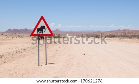 Caution: Elephants! Road sign standing beside road, Namibia, Africa - stock photo