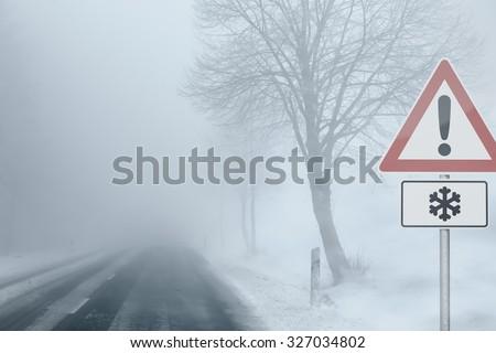 Caution - Foggy Winter Road - stock photo