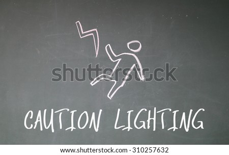 caution lighting on blackboard - stock photo