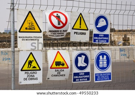 Caution, Required sign in construction area. - stock photo