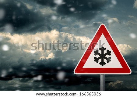 caution snow - snow clouds with warning sign