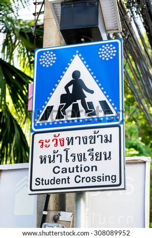 Caution student crossing signboards. - stock photo