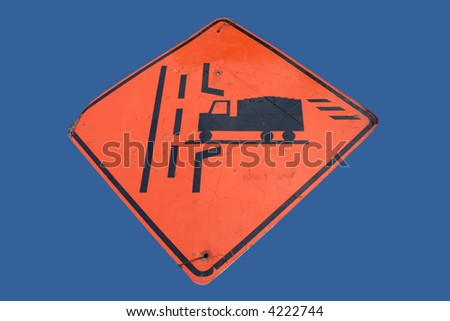 Caution trucks crossing sign isolated on blue - stock photo