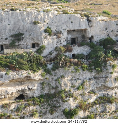Cave dwellings in Mellieha valley - stock photo