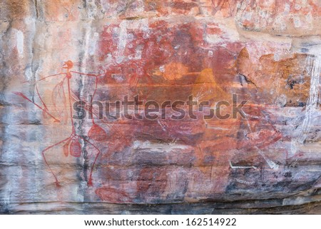 Cave painting of primitive commune on the wall - stock photo