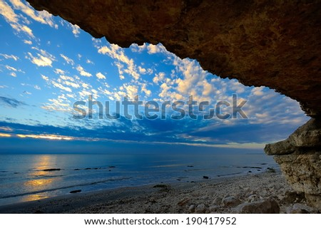 cave paradise, sea and sky relaxation paradise on beach  - stock photo