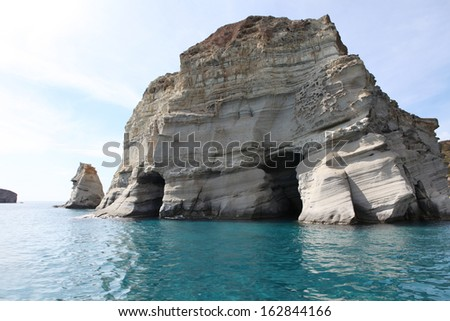 Caves and rock formations by the sea at Kleftiko area on Milos island,a Greece - stock photo