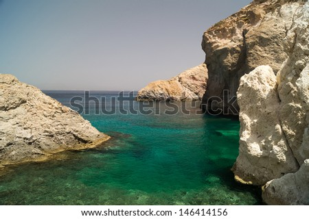 Caves and rock formations by the sea at Sarakiniko area on Milos island,a Greece - stock photo