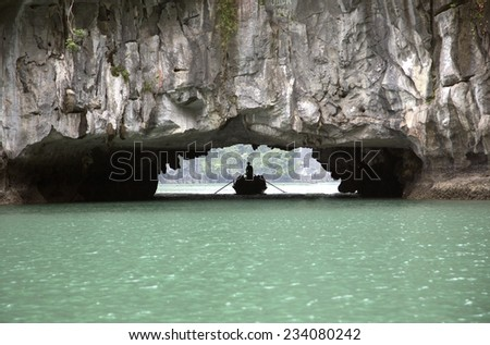 Caves and Tourist Boat Ha Long Bay Vietnam - stock photo
