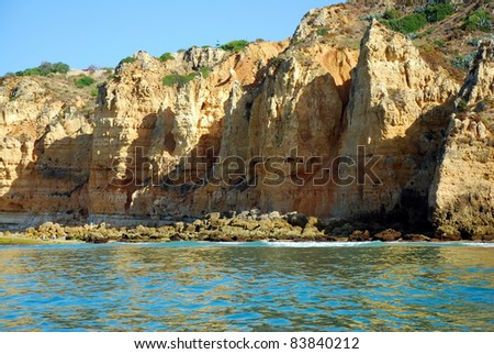 Caves in the cliffs yellow in Lagos in the Algarve Portugal