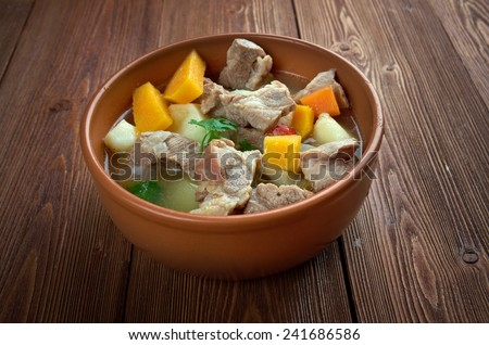 Cawl - Welsh dish.Wales bacon or beef with potatoes, swedes, carrots and turnip  - stock photo