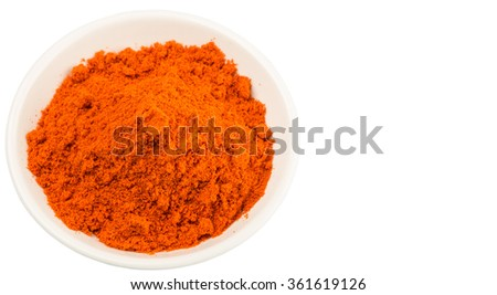 Cayenne pepper powder in white bowl over white background