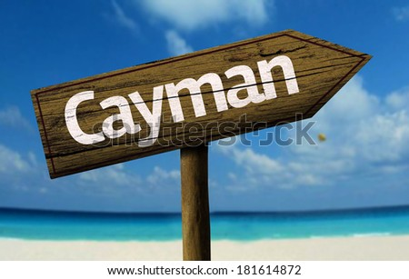 Cayman wooden sign with a beach on background - stock photo