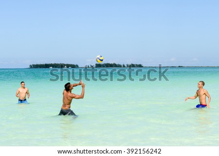 Cayo Guillermo, Cuba - 16 january 2016: people playing volleyball in clear water of Cayo Guillermo beach, Cuba