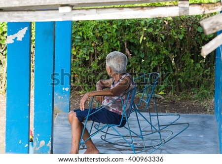 CAYO SANTA MARIA, CUBA - JUNE 26, 2015: Cuban relexed front of your home in a rocking chair