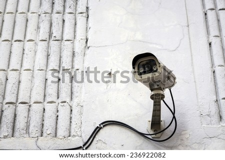cctv camera for security fix at exterior of building - stock photo