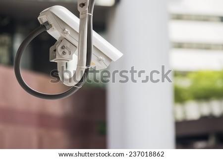 cctv camera in major city - stock photo