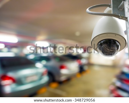 cctv camera installed on the parking lot to protection security - stock photo