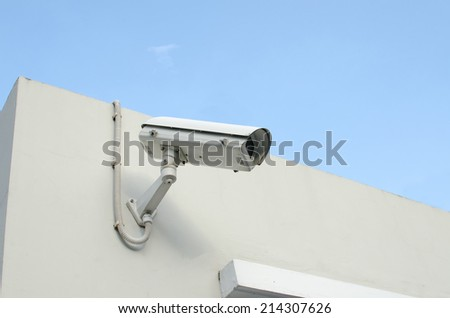 CCTV camera on a wall watch rigth.