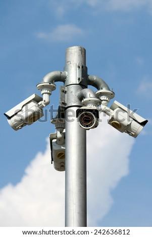 CCTV camera on the pole - stock photo