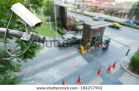 CCTV Camera Operating at gate - stock photo