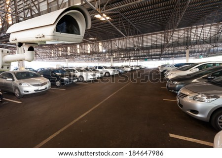 CCTV Camera Operating in garage or car park - stock photo