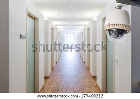 CCTV Camera Operating inside dormitory or apartment - stock photo