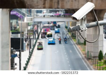 CCTV Camera Operating on road detecting traffic - stock photo