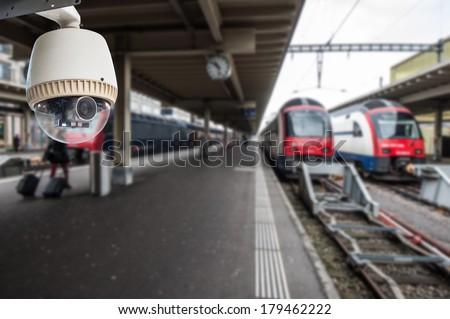 CCTV Camera Operating on train station platform - stock photo