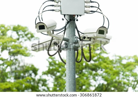 CCTV camera or surveillance operating - stock photo