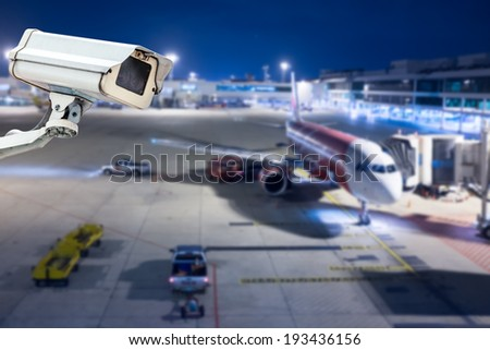 CCTV camera or surveillance operating in airport - stock photo