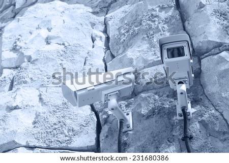 cctv camera outdoor on wall - stock photo