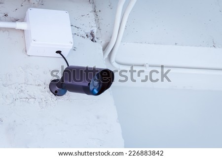 cctv camera security on wall background in room for safety concept - stock photo