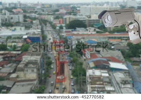 cctv camera with modern building blur background - stock photo