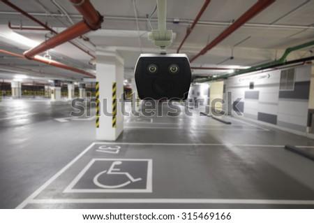 CCTV cameras in a car park building. - stock photo