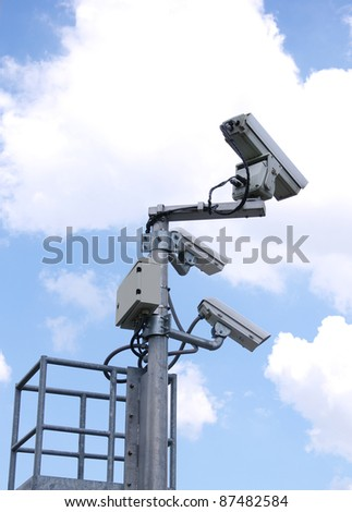 CCTV Cameras in the background sky - stock photo