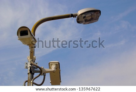 CCTV cameras on light poles passage. - stock photo
