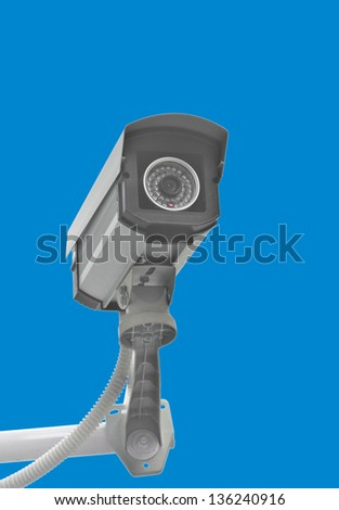 CCTV for security in the city on blue background. - stock photo