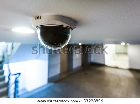 CCTV in building in front of elevator - stock photo