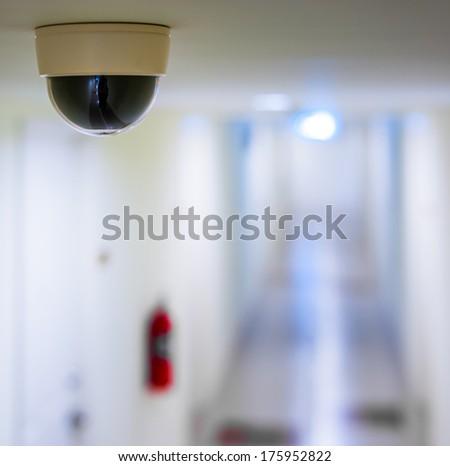 CCTV in condominium in front of rooms - stock photo