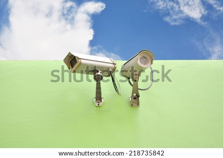 CCTV On Wall and Sky Background