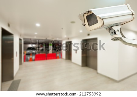 CCTV operating in car park building with elevator - stock photo