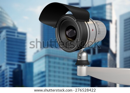 CCTV security camera on background of office buildings - stock photo