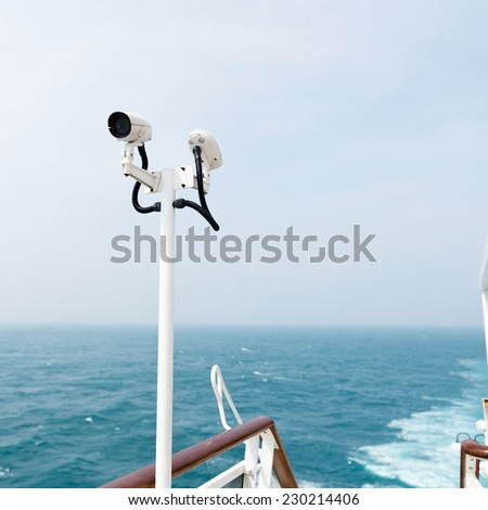 CCTV security camera on deck of cruise ship. - stock photo