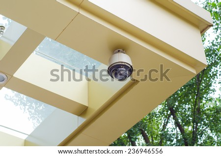 CCTV security camera on the wall - stock photo