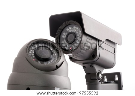 CCTV surveillance cameras isolated on white - stock photo