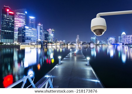 CCTV with night cityscape background - stock photo
