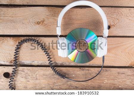 CD and headphones - stock photo