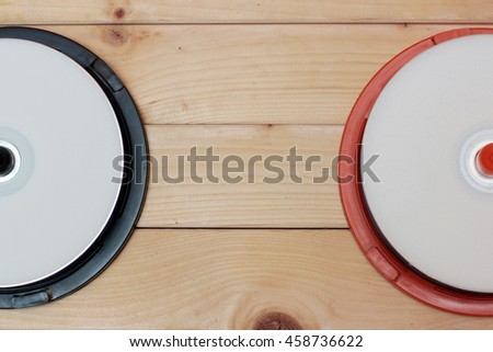 CD drives on wooden background retro - stock photo