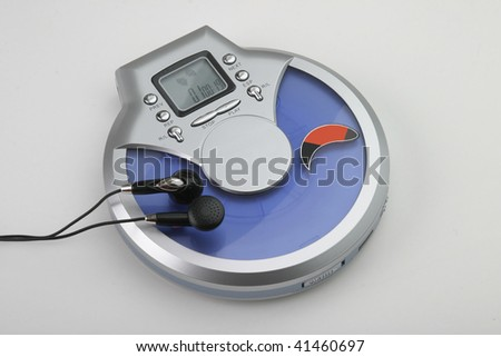 CD-DVD a player with headphones - stock photo
